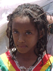 Ethiopian girl with parted eyebrow and full rounded forehead.