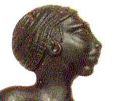 African figure with receeding forehead